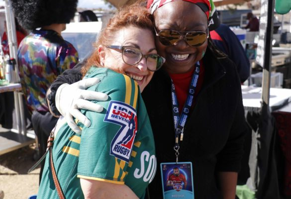 Jennifer Gachui hugs her customer dressed in South African team jersey after the customer jokingly tried to photo-bomb her.
